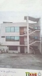Foto Casa de tres pisos