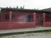 Foto Terreno esquinero con cerramiento y casa pequeña