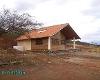 Foto Terreno con casa estilo rústico en Catamayo