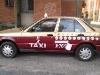 Foto Taxi con placas serie A 09