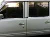 Foto Camioneta Nissan blanca doble cabina