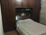 Foto Guarda Roupa de madeira com cama embutida